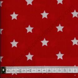 Tissu coton enduit avec étoiles sur fond rouge